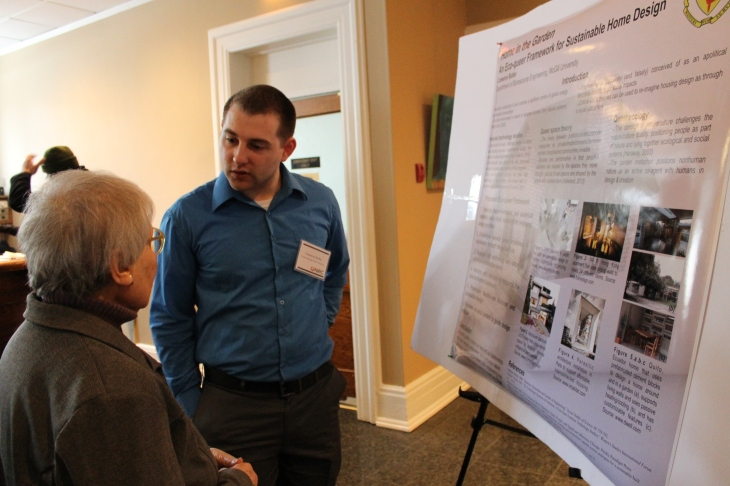 Cameron Butler explains his research to engaged guests at NiRC 2014. (Deborah Baremberg / Freelance photographer)